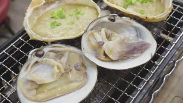 grilled japanese sea food - カニ点の映像素材/bロール