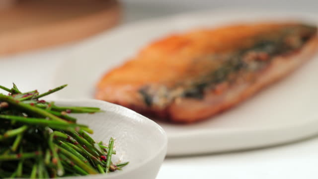 grilled mackerel and 'buchu muchim' (korean-style garlic chive salad) - chive stock videos & royalty-free footage