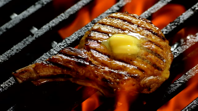 grilled pork chop with butter on the top on barbecue grill - fast motion - butter stock videos and b-roll footage