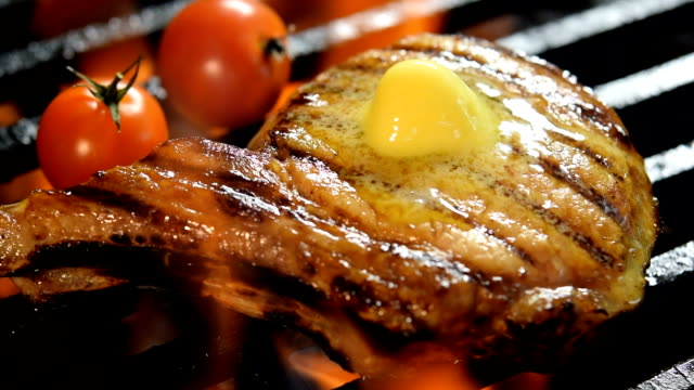 grilled pork chop with butter on the top on barbecue grill - steak stock videos and b-roll footage