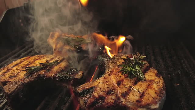grilled pork chops with spices and herbs bbq celebration in western colorado 4k video - juicy stock videos & royalty-free footage