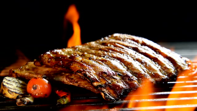 grilled pork ribs/steak on the flaming grilled - rib food stock videos and b-roll footage