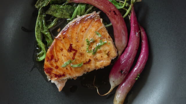 grilled salmon fillet with roasted organic radishes - gourmet stock videos & royalty-free footage