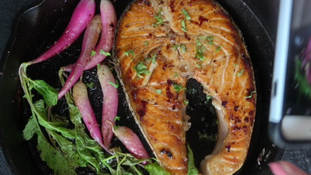 grilled salmon fillet with roasted organic radishes - filleted stock videos & royalty-free footage