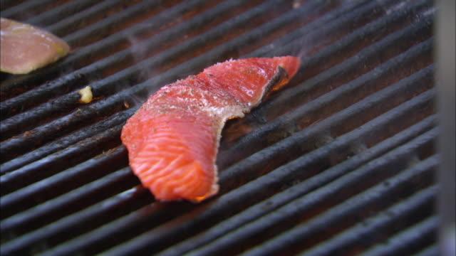 grilled salmon steak - salmon steak stock videos & royalty-free footage