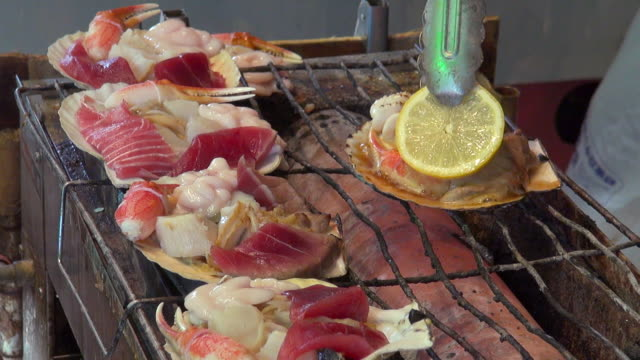 grilled seafood in a shell - japan stock videos & royalty-free footage