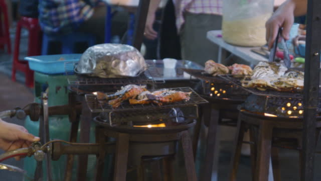 grilled seafood on night street food in chiang mai, thailand. - roast chicken stock videos & royalty-free footage
