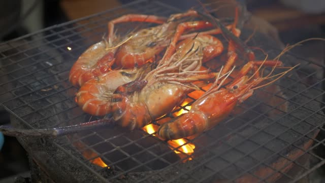 grilled shrimp on a charcoal stove - scampi seafood stock videos and b-roll footage