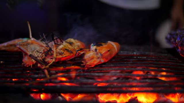 grilled shrimps in fire ,slo-mo - throwing stock videos & royalty-free footage