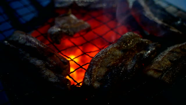 grilled slice of pork on traditional stove - thai food stock videos & royalty-free footage