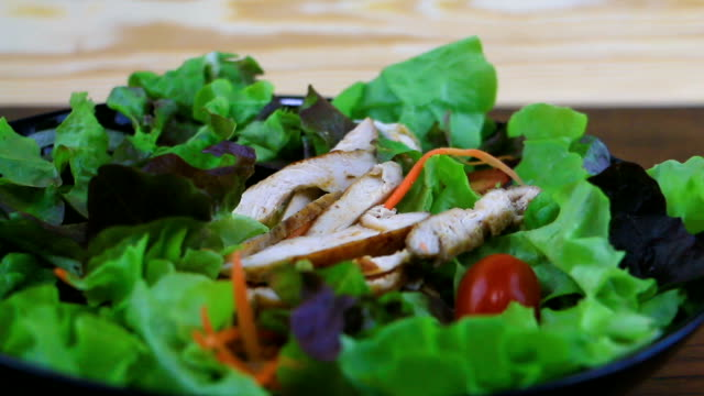grilled slide chicken with tomato and vegetable salad. - tomato salad stock videos & royalty-free footage