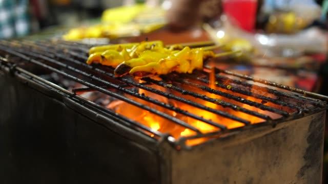 grilled squid on skewer in street food, thailand - skewer stock videos & royalty-free footage