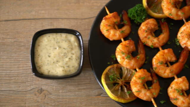 grilled tiger shrimps skewers with lemon - prawn animal stock videos and b-roll footage