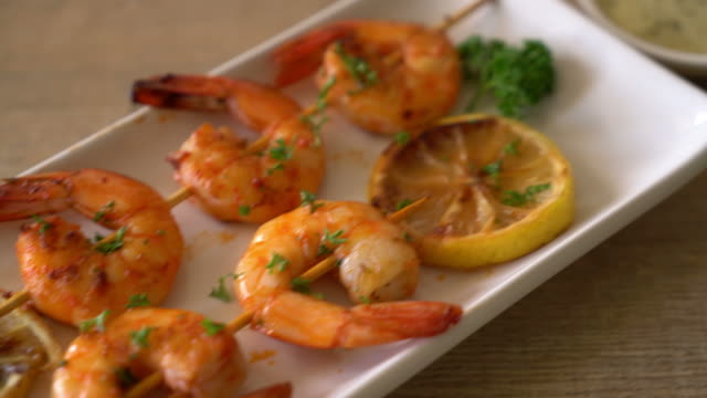 grilled tiger shrimps skewers with lemon - grilled stock videos and b-roll footage