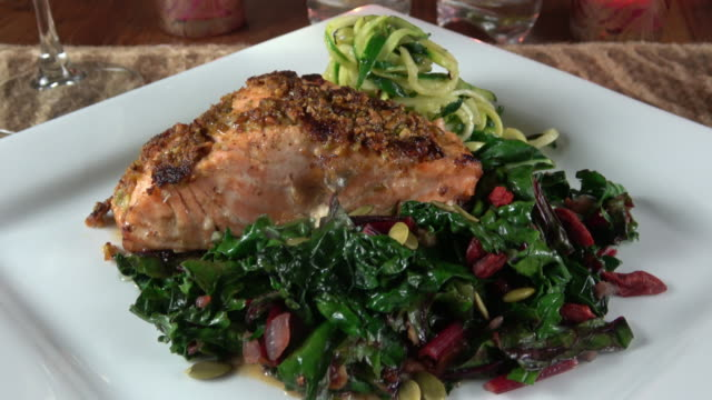 grilled wild salmon filet with collard greens and zoodle (zucchini noodle) - grilled salmon stock videos & royalty-free footage