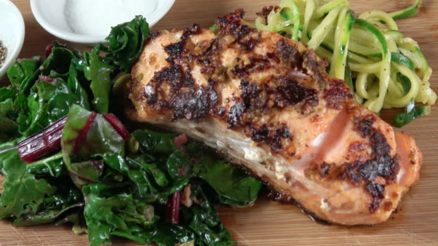 grilled wild salmon filet with collard greens and zoodle - saute stock videos and b-roll footage