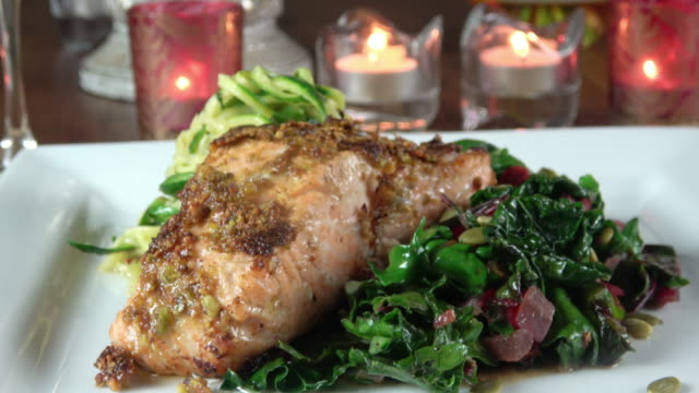 grilled wild salmon filet with collard greens and zoodle - grilled salmon stock videos & royalty-free footage