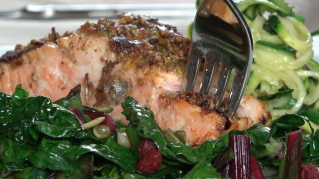 grilled wild salmon filet with collard greens and zoodle - salmon stock videos & royalty-free footage