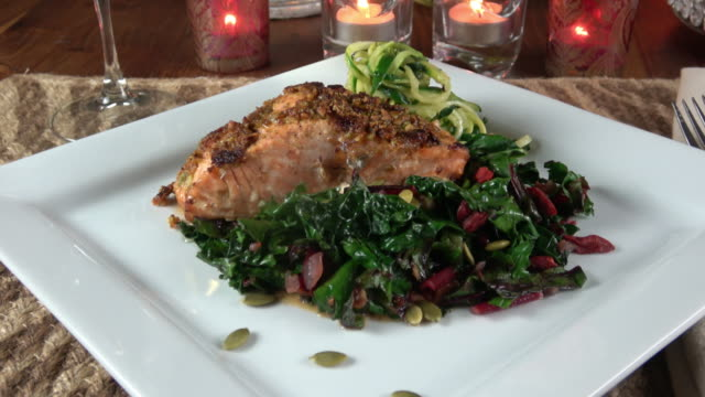 grilled wild salmon filet with collard greens and zoodle (zucchine noodle) - grilled salmon stock videos & royalty-free footage