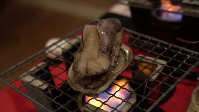Grilling abalone on the barbecue