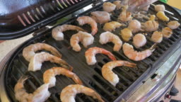 Grilling Fresh Seafood on a Barbecue Grill in 4k
