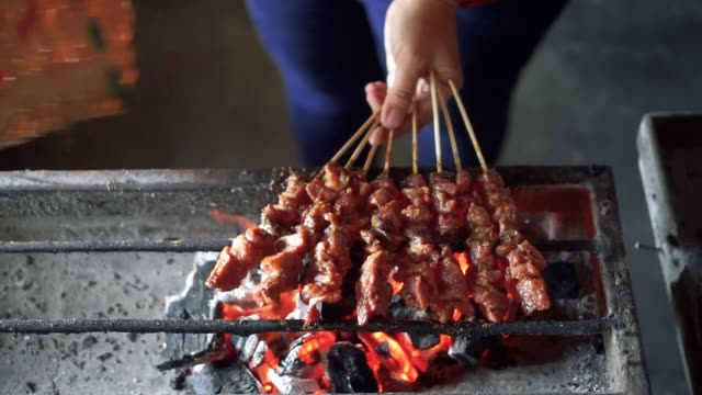 grilling goat meat satay - table top view stock videos & royalty-free footage
