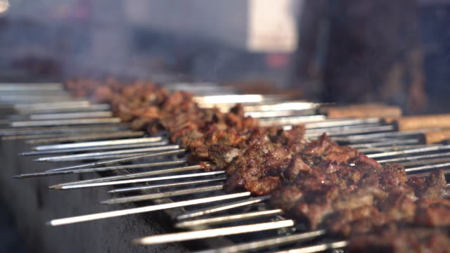 cu grilling meat at the market in oman - oman stock videos & royalty-free footage