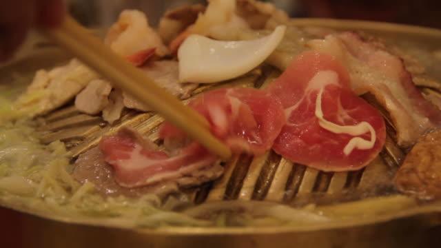 grilling pork. - crucifers stock videos & royalty-free footage