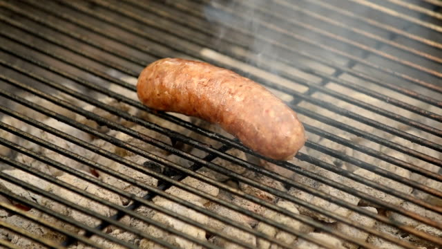 grilling sausage on the barbecue - briquette stock videos & royalty-free footage