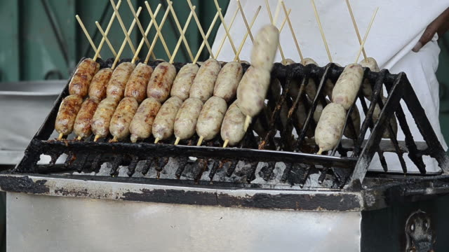 grilling sausages on street thailand - thai food stock videos & royalty-free footage