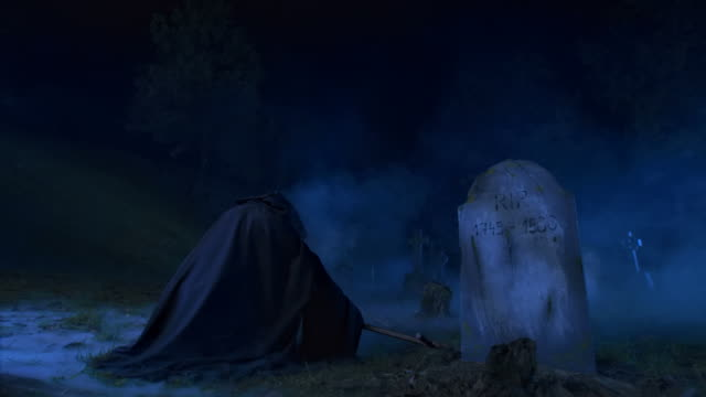 hd dolly: grim reaper in cemetary - evil stock videos and b-roll footage
