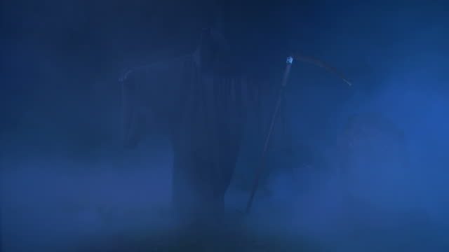 hd: grim reaper shrouded in fog - scythe stock videos and b-roll footage