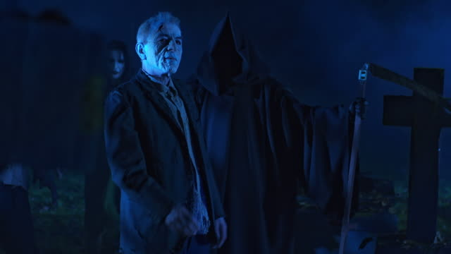 HD: Grim Reaper Watching Over The Deceased