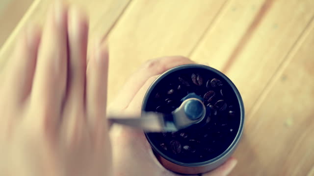 grind coffee by hand - macinare video stock e b–roll