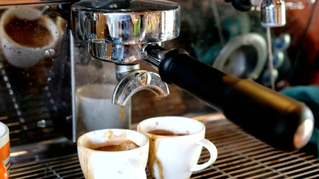 grinder expresso with large coffee maker pouring on cup - grinding stock videos & royalty-free footage