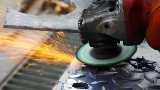 Grinder is grinding steel plate
