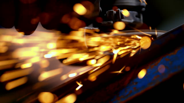 slo mo grinding a piece of steel - metal industry stock videos and b-roll footage