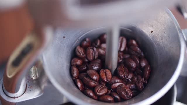 grinding coffee beans - bean stock videos & royalty-free footage