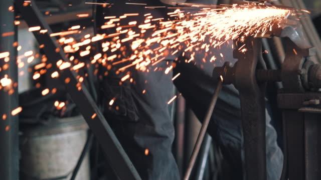 grinding in blacksmith workshop - blacksmith stock videos & royalty-free footage