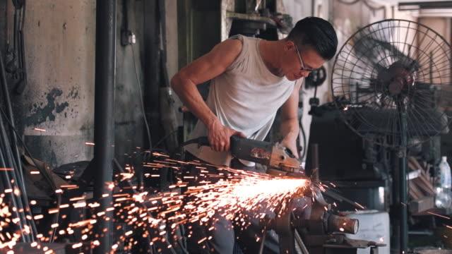 Grinding in blacksmith workshop