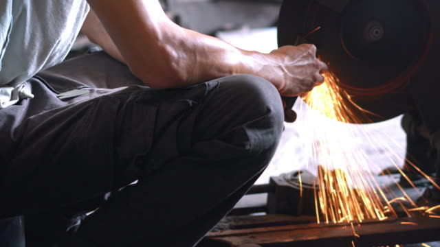 grinding in blacksmith workshop - one mid adult man only stock videos & royalty-free footage