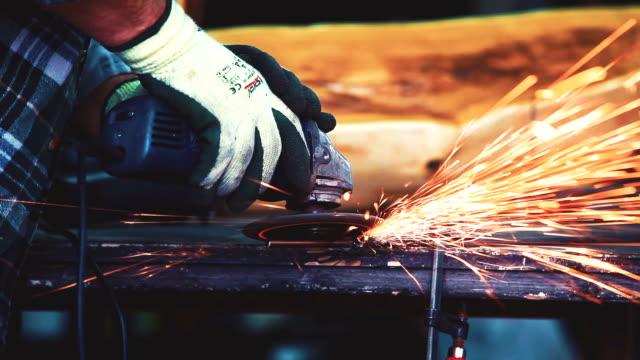 grinding metal in workshop - welding torch stock videos & royalty-free footage