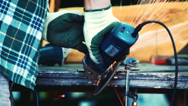 grinding metal in workshop - workbench stock videos & royalty-free footage