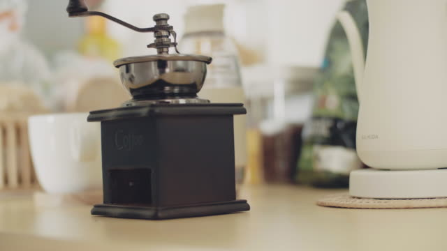 grinding the seeds of coffee. - one mature man only stock videos & royalty-free footage