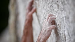 SLO MO PAN Grip of a male rock climber's hand