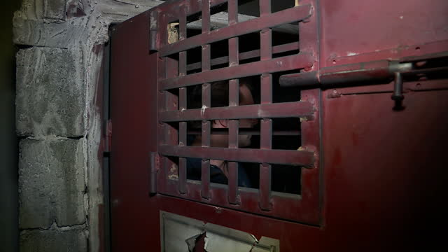 grisly discoveries in town liberated from isis showing interior shots looking around former isis prison demonstrating tiny cell prisoners were kept... - folter stock-videos und b-roll-filmmaterial