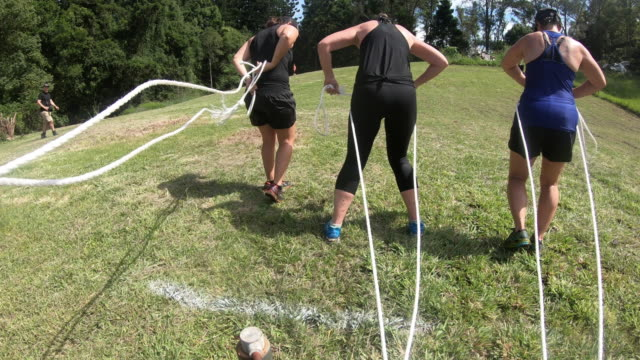 Gritty Women exercising outdoor bootcamp Australia Pulling Trailer