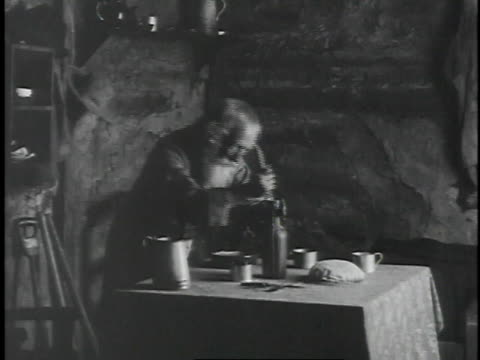 1926 montage grizzled, bearded man setting a table and lighting a candle / united states - 1926 stock videos & royalty-free footage