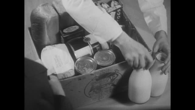 1938 groceries are packed tightly into a box - bread stock videos & royalty-free footage