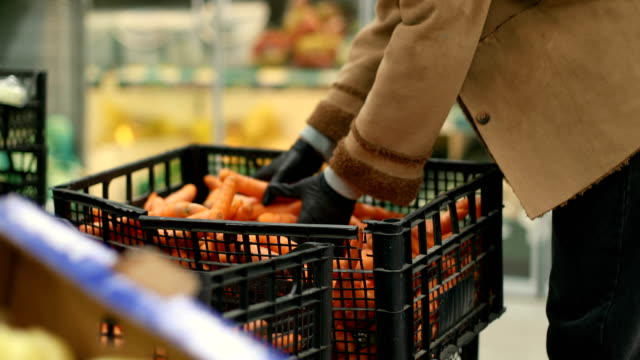 groceries during covid-19 - carrot stock videos & royalty-free footage